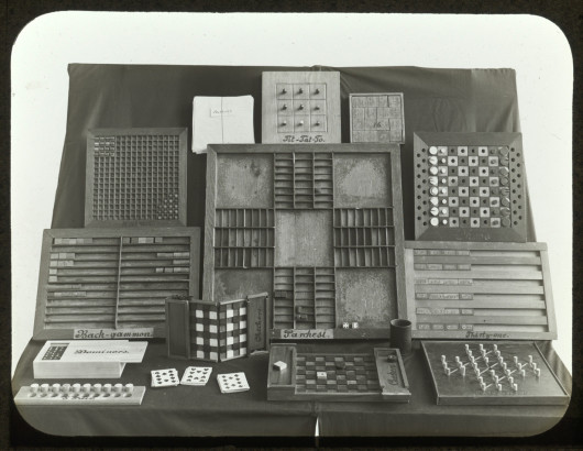 Display of tactile table games for the blind including Tic-tac-toe, Back-gammon, Dominoes, 5-Pair, Checkers, Halma, Authors, Parchesi, Chess, Thirty-one, and Solitair